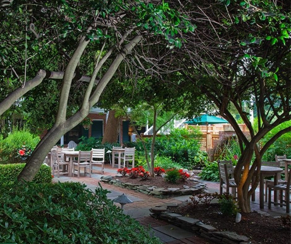 Lush gardens with a sitting area at The Bellmoor Inn & Spa.