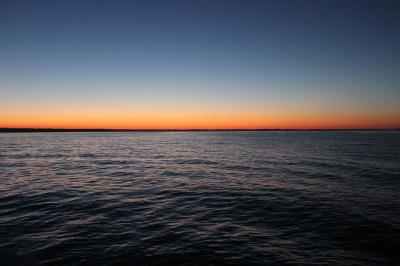 sunset view over the lake at tawas, michigan