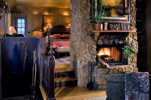 Inn at Irish Hollow guest room with roaring fire in stone fireplace