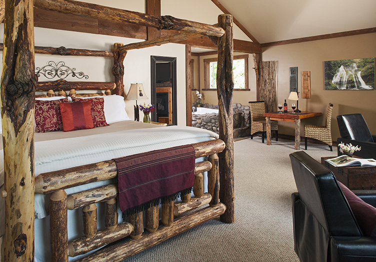 carson ridge luxury cabin interior of bedroom with wooden furnishings
