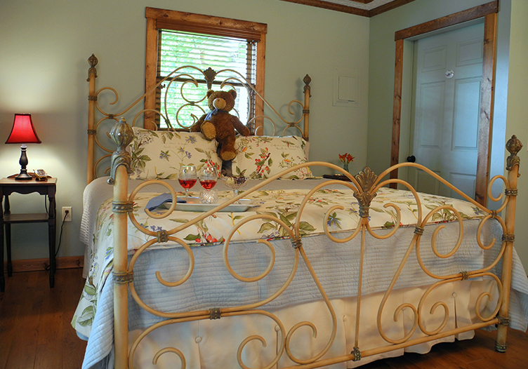 Blueberry Cabin ornate bed frame beautiful furnshings