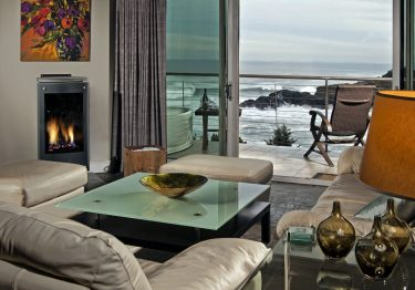 sofas overlooking pacific ocean through french doors
