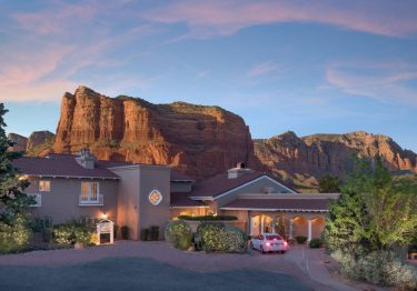 canyon villa in front of red rocks formation