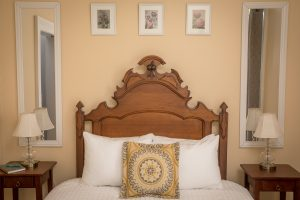 Aldrich Guest House Room With Beautiful Wooden headboard