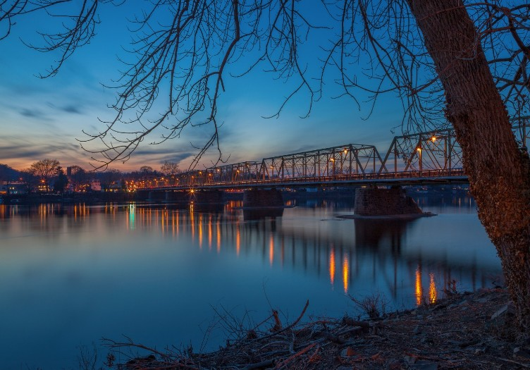 winter scene of lambertville to new hope bridge in the evening