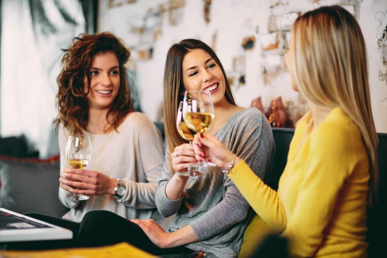 Three women drinking white wine on a girls getaway weekend!