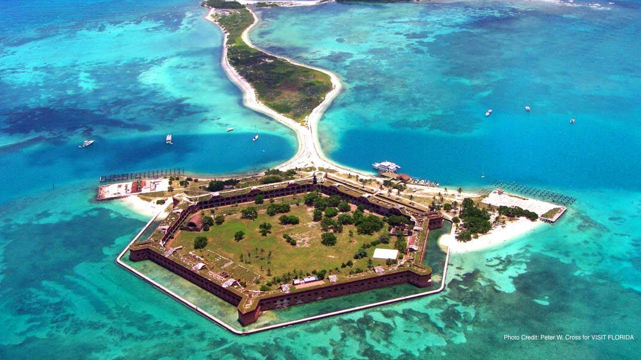 aerial view of island fort jefferson in crystal clear water