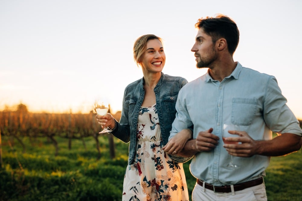 A young couple enjoying Enjoy Wine Tasting at the best Northern Georgia Wineries This Summer